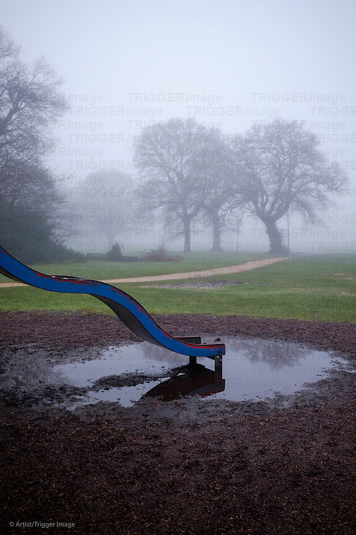 Playground in a misty park