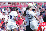 27 August 2006,  Han Wenxia (CHN) goalie tries to block a free kick by Kristine Lilly (USA)(not in picture) while Abby Wambach (USA)(20) and Natasha Kai (USA)(6) get airborne trying to get their head on the ball.  .The USA Women's National Team defeated China by a score of 4-1 in an international friendly match at Toyota Park, Bridgeview, Illinois.