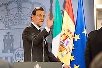 Mariano Rajoy salutes at end of press conference of Hispano-Italian meeting