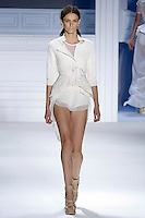 Erjona Ala walks runway in a White super pique jacket with striped linen-silk drawstring parachute back and double layer drawstring peplum, and White stetxh cotton boy shorts, by Vera Wang, for the Vera Wang Spring 2012 collection, during Mercedes-Benz Fashion Week Spring 2012.