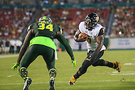 Tampa, FL - September 3, 2016: Towson Tigers running back Darius Victor (7) looks to run past South Florida Bulls safety Malik Dixon (34) during game between Towson and USF at the Raymond James Stadium in Tampa, FL. September 3, 2016.  (Photo by Elliott Brown/Media Images International)