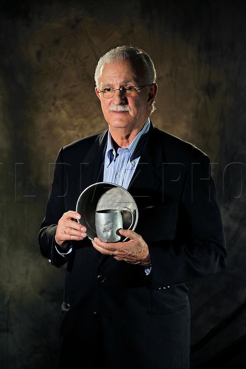 Eduardo Zaya-Bazan holds the tin cup and tin plate he used while in captivity in Cuba. He is a member of the Bay of Pigs Veterans Association, Brigade 2506