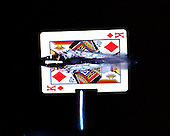 High-speed photo showing a bullet exploding through a playing card.