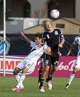 Steven Lenhart of Earthquakes fights for the ball against Marcelo Sarvas of Galaxy during the game at Buck Shaw Stadium in Santa Clara, California on October 21st, 2012.  San Jose Earthquakes and Los Angeles Galaxy tied at 2-2.