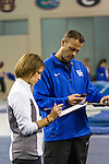 (Left to Right) Assistant Coach Mary McDaniel and Head Coach Tim Garrison confer with each other and add up the scores after the competition was over. The White team barely edged out the Blue Team in Thursday night's scrimmage. in Lexington, Ky., on Thursday, December, 6, 2012. Photo by James Holt | Staff