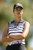 March 28, 2004; Rancho Mirage, CA, USA;  14 year old amateur Michelle Wie waits her turn during the final round of the LPGA Kraft Nabisco golf tournament held at Mission Hills Country Club.  Wie finished the day with a 1 under par 71.  Her overall score of 7 under par 281 was low enough to win low amateur honors and 4th place overall.<br />