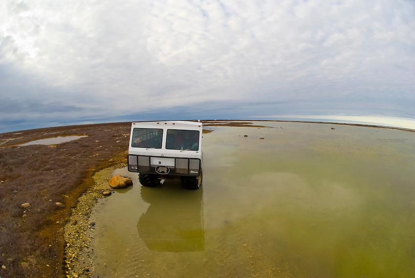 A tundra buggy in search of polar bears along Hudson Bay, near Churchill, Manitoba, Canada