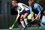 15 November 2014: Liberty's Cassidy Bremner (CAN) (left) and North Carolina's Emma Bozek (right). The University of North Carolina Tar Heels hosted the Liberty University Flames at Francis E. Henry Stadium in Chapel Hill, North Carolina in a 2014 NCAA Division I Field Hockey Tournament First Round game. UNC won the game 2-1.