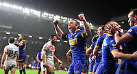 PICTURE BY SIMON WILKINSON/SWPIX.COM...Rugby League - Super League Grand Final 2011 - St Helens Saints v Leeds Rhinos - Old Trafford, Manchester, England - 08/10/11…St Helens Leeds..Leeds captain Kevin Sinfield celebrates another Leeds try