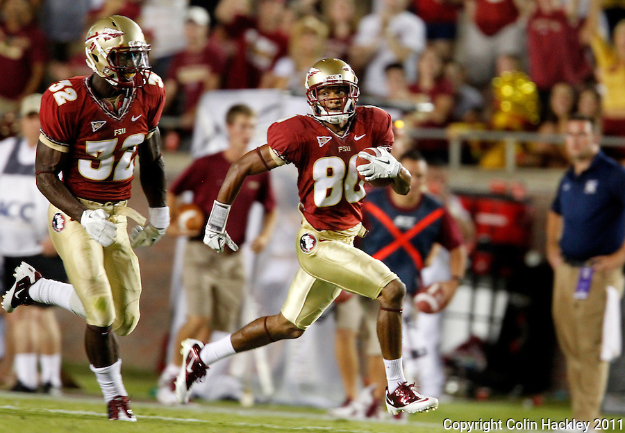 TALLAHASSEE, FL 10-FSU-CSU091011 CH-Florida State's Rashad Greene, right, races for the endzone as James Wilder, Jr., left, escorts during second half action against Charleston Southern Saturday at Doak Campbell Stadium in Tallahassee. The Seminoles beat the Buccaneers 62-10..COLIN HACKLEY PHOTO