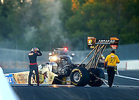 Sep 3, 2016; Clermont, IN, USA; NHRA top fuel driver Morgan Lucas climbs from his car after blowing an engine during qualifying for the US Nationals at Lucas Oil Raceway. Mandatory Credit: Mark J. Rebilas-USA TODAY Sports