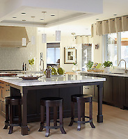 This custom kitchen features a handmade Tatewaku backsplash shown in Calacatta Tia and polished Gascogne Blue from the Silk Road Collection by Sara Baldwin for New Ravenna.<br />