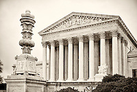 Supreme Court of the United States.Washington DC Photography US Supreme Court   Washington DC<br /> The Supreme Court building, located on Capitol Hill in Washington DC,  is the seat of the Supreme Court of the United States. It is situated in Washington, D.C one block east of the United States Capitol.  Architectural detail of the west fa&ccedil;ade includes striking columns and bears the motto &quot;Equal Justice Under Law,&quot;.  A national icon and popular tourist attraction in Washington DC.