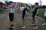 23 February 2017: Notre Dame's Sydney Cardozo (9) and Notre Dame's Sydney Flynn (26) have their sticks checked before the game. The Elon University Phoenix hosted the University of Notre Dame Fighting Irish at Rudd Field in Elon, North Carolina in a 2017 Division I College Women's Lacrosse match. Notre Dame won the game 16-7.