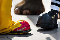Clowns wear oversized shoes during the Clown Congress in San Salvador, El Salvador, 18 May 2011. The clown performance is considered a regular job in most of Latin American countries. Clowns may work individually or in groups, often performing advertisement like acts in large open-to-street shops or they take part in private shows, like children birthdays, family events etc. There are many clown conventions all over Latin America where clowns gather and exchange their experiences offering workshops of the comic acting or the art of make-up. For some of them, being clown is a serious lifetime profession.