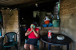 November 08, 2014. &quot;Water it&acute;s the real thing&quot;<br /> Raquel lives with her family in Nejapa (El Salvador). Life is so difficult for her because she does'n' t have water at home. The people of Nejapa have no drinking water because the Coca -Cola company overexploited the aquifer in the area, the most important source of water in this Central American country. This means that the population has to walk for hours to get water from wells and rivers. The problem is that these rivers and wells are contaminated by discharges that makes Coca- Cola and other factories that are installed in the area. The problem can increase: Coca Cola company has expansion plans, something that communities and NGOs want to stop. To make a liter of Coca Cola are needed 2,4 liters of water. &copy;Calamar2/ Pedro ARMESTRE