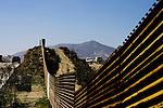 \US Border Patrol Agents patrol the US-Mexico border fence near Tecate, Mexico on Wednesday, April 12, 2006.<br />