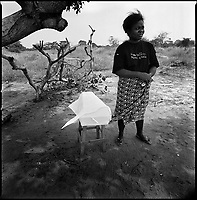 Luanda, Angola, May 21, 2006.Vivi, 36, waits to bury baby Humberto, 9 days, the son of her sister Sonia, 28, at Mulevos cemetery. Children mortality is very high in Angola especially in Luanda slums area, where water and food are infected by cholera and malaria is endemic.