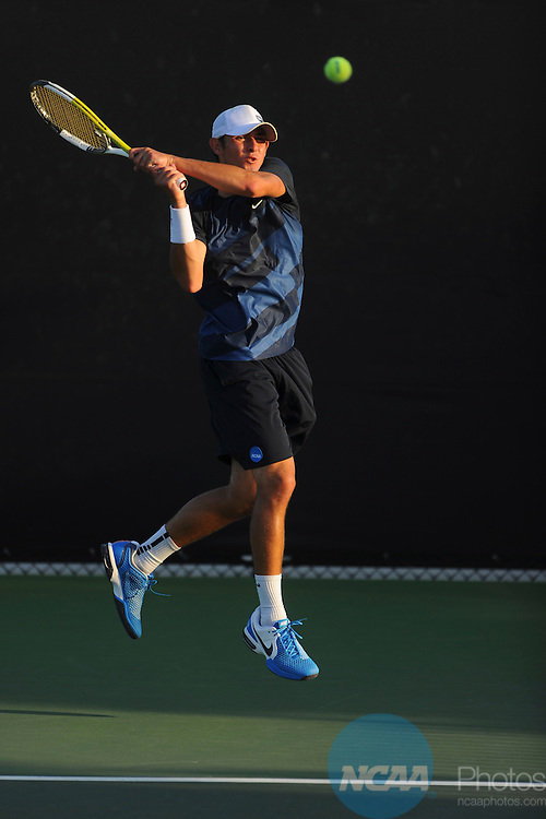 26 MAY 2011: Dillon Pottish of Emory returns a serve during the Division III Men's Tennis Championship held at the Biszantz Family Tennis Center and Pauley Tennis Complex in Claremont, CA. Amherst defeated Emory 5-2 for the national title. Stephen Nowland/NCAA Photos