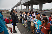 Job seekers from the countryside arrive on the edge of Chongqing city to apply for work at the Foxconn factory. <br /> <br /> The workers, mostly children of farmers, are part of a generation that is quickly urbanizing. <br /> <br /> They are being picked up at the light rail station for  interview at Apple's contract factory. If they succeed, they would land jobs making Apple products including the iPhone. <br /> <br /> Foxconn hit the news last year when it was rocked by a series of workers' suicide. <br /> <br /> China is pushing ahead with a dramatic, history-making plan to move 100 million rural residents into towns and cities between 2014 and 2020 &mdash; but without a clear idea of how to pay for the gargantuan undertaking or whether the farmers involved want to move.<br />