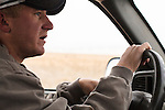 Brett Oelke drives to inspect a center pivot irrigation system on his family's 6,000-acre farm outside of Hoxie, Kan., on Friday, Oct. 12, 2012. As historically dry conditions continue, farmers from South Dakota to the Texas panhandle rely on the Ogallala Aquifer, the largest underground aquifer in the United States, to irrigate crops. After decades of use, the falling water level ? accelerated by historic drought conditions over the last two years ? is putting pressure on farmers to ease usage or risk becoming the last generation to grow crops on the land. Farmers like Mitchell Baalman (not pictured) and Brett Oelke are part of a farming community in in Sheridan County, Kansas, an agricultural hub in western Kansas, who have agreed to cut back on water use for crop irrigation so that their children and future generations can continue to farm and sustain themselves on the High Plains.