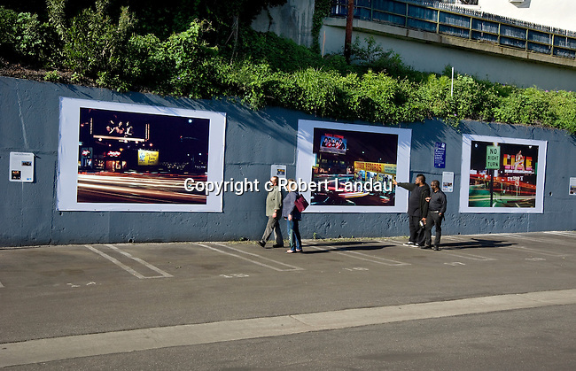 Installation of outdoor art exhibit at the West Hollywood parking lot on the Sunset Strip in Los Angeleles featuring Robert Landau's photos documenting the classic hand-painted rock billboards from the 1960s and 70s.