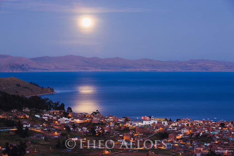 Bolivia, Altiplano, full moon over Copacabana and Lake Titicaca  with full moon at dawn; Copacabana is the main Bolivian town on the shore of Lake Titicaca