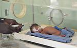 Nurse Angelo Ariec uses a feeding tube to feed a premature baby in an incubator at the St. Daniel Comboni Catholic Hospital in Wau, South Sudan.