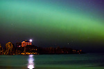 Marquette Lighthouse and bright green aurora arc