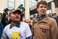 Moscow, Russia, 01/10/2012..Pussy Riot supporters sing the band's songs outside Moscow City Court. Supporters and opponents of band members Maria Alyokhina, Yekaterina Samutsevich and Nadezhda Tolokonnikova demonstrated outside the court as the three appealed against their two-year jail sentence for their performance in the Christ The Saviour Cathedral. The appeal was postponed until October 10th after Samutsevich fired her lawyer.
