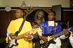 The Church of God of Prophecy north London. Church band accompany the choir. from A STORM IS PASSING OVER a Look at Black Churches in Britain. Published by Thames and Hudson isbn 0 500 27826 1