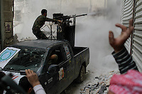 Free Syria Army (FSA) soldiers battle loyalist soldiers in the Askar neighborhood of Aleppo. FSA soldiers used a DShK 12.7mm machine gun in an attempt to dislodge a regime sniper positioned at one of the buildings overlooking two main roads. ..© AFP/Javier Manzano..............