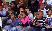 Chicago, IL - November 26, 2008 -- Children attending St. Columbanus Parrish and School react as United States President-elect  Barack Obama enters the room to talk to them Wednesday, November 26, 2008, in Chicago, Illinois. .Credit: Frank Polich - Pool via CNP