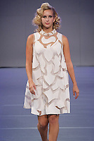 Model walks the runway in an outfit from the Tammy Duffy collection fashion show, during Couture Fashion Week Spring 2012.