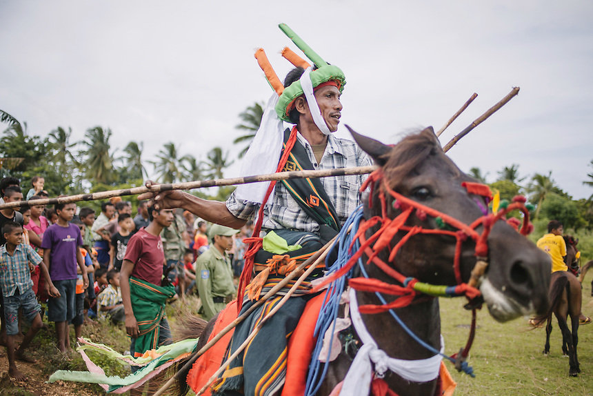 Johanes Ndara Kepala, a senior Pasola warrior, ready to charge during the event in Waiha, Kodi. Pasola is an ancient tradition from the Indonesian island of Sumba. Categorized as both extreme traditional sport and ritual, Pasola is an annual mock horse warfare performed in response to the harvesting season. In the battelfield, the Pasola warriors use blunt spears as their weapon. However, fatal accident still do occurs.