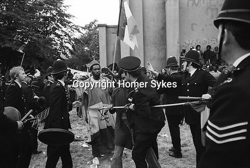 Notting Hill Nottinghill Gate Carnival Riot, London W11 England 1976. A group of Rastafarians were chanting and drumming peacefully. The police broke the group up thinking they were rioters.