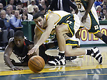 Miami Heat's Dwayne Wade. left, and Seattle Supersonics' Vladimir Radmanovic of Serbia &amp; Montenegro, (77) go for a loose ball in the first quarter at Key Arena in Seattle, Washington  on Friday, 13 March 2005.  Jim Bryant Photo. &copy;2010. All Rights Reserved.
