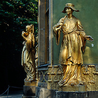 A pair of gilded female figures playing musical instruments decorate the exterior of the Chinese Tea Pavilion in the Sanssouci Park, Potsdam