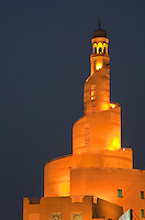 Doha, Qatar.  Kassem Darwish Fakhroo Centre, based on the Great Mosque of al-Mutawwakil, in Samarra, Iraq.  Headquarters of the Qatar Islamic Cultural Center.  Night Scene.