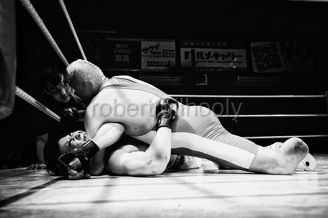Wrestlers grapple during a bout at Doglegs, an event for wrestlers with physical and mental handicaps in Tokyo, Japan.