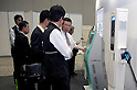 May 131, 2012, Tokyo, Japan - Visitors come to the Smart Grid Exhibition and Automotive Next Industry Fair to watch the new vehicles and manufacturing technologies. The Smart Grid Exhibition and Automotive Next Industry Fair 2012 shows the next generation of vehicles and manufacturing working with eco energy, from May 30th. to June 1st. at Tokyo Big Site. ..J