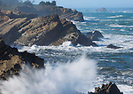 Oregon, Southwest, Coos Bay. Waves crashing against the rocks in Shore Acres State Park on the Pacific Coast.