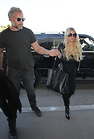 OCT 22 Jessica Simpson seen at LAX Airport in Los Angeles