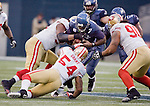 Seattle Seahawks quarterback Tarvaris Jackson is sacked for a loss by San Francisco 49ers Larry Grant (54), Isaac Sopoaga (90) and Parys Haraison, left, at  CenturyLink Field in Seattle, Washington on December 24, 2011.  The 49ers came from behind to beat the Seahawks 19-17. ©2011 Jim Bryant Photo. All Rights Reserved.