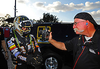 Jan. 17, 2012; Jupiter, FL, USA: NHRA photographer Roger Richards (right) photographs top fuel dragster driver Tony Schumacher during testing at the PRO Winter Warmup at Palm Beach International Raceway. Mandatory Credit: Mark J. Rebilas-