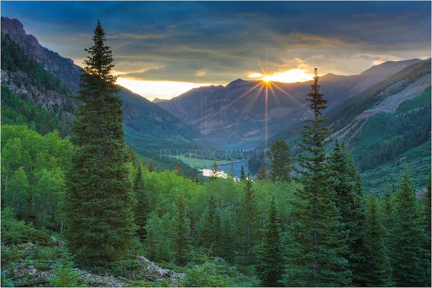 I had shot the moonset over the Maroon Bells before I started the hike up to Crater Lake. When I turned around at one point in the trek, I realized I had to stop and photograph this classic Colorado landscape image - sunrise over Maroon Lake. The winds were calm and the sun was able to peek through the clouds for a brief moment. The irony of this image is that I had waited for about 10 minutes for the sun to rise over the distant mountains. I finally figured the clouds would win out. I packed up my tripod and camera and started up the trail only to realize the sun was making an appearance. I quickly reset everything and captured this lone image before the sun vanished again.