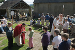 The annual Padley Martyrs Roman Catholic Pilgrimage. Padley, Padley Chapel, Grindleford, Derbyshire  UK 2008. Young girl recieves Holy Communion from Bishop  John Arnold.