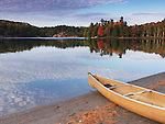 Canoe on a shore of George lake. Beautiful fall nature scenery. Killarney Provincial Park, Ontario, Canada.