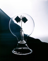 CROOKES RADIOMETER<br /> 4 black &amp; white vanes attached to a rotating shaft in a vacuum are moved by the absorption &amp; reflection of heat from ordinary light- a demonstration of the effect of radiant energy.