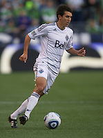 Vancouver Whitecaps FC  midfielder Shea Salinas dribbles the ball during play against the Seattle Sounders FC at Qwest Field in Seattle Saturday June 11, 2011. The game ended in a 2-2 draw.